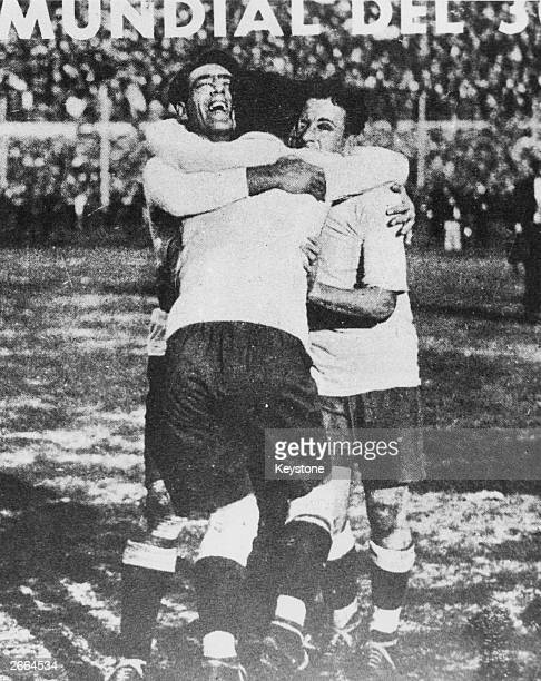 Footballers Lorenzo Fernandez Pedro Cea and Hector Scarone of the Uruguay national team celebrating winning the first World Cup competition at...