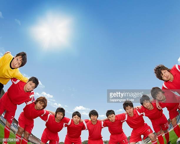 Footballers Making Huddle