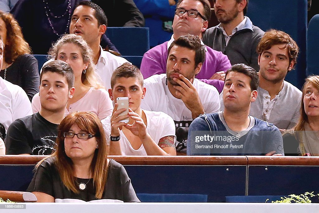 Footballers Marco Verratti (CL) and Salvatore Sirigu (CR) attend the match between Novak Djokovic of Serbia and Roger Federer of Switzerland during day six of the BNP Paribas Tennis Masters, held at Bercy on November 2, 2013 in Paris, France.