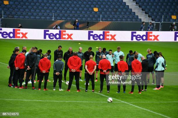 Footballers of Ajax stand in silence for the victims of Manchester Arena stadium explosion during the training session ahead of the UEFA Europa...