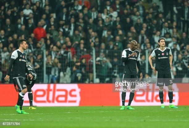 Footballers of Besiktas react after Adanaspor scored a goal during the Turkish Spor Toto Super Lig football match between Besiktas and Adanaspor at...