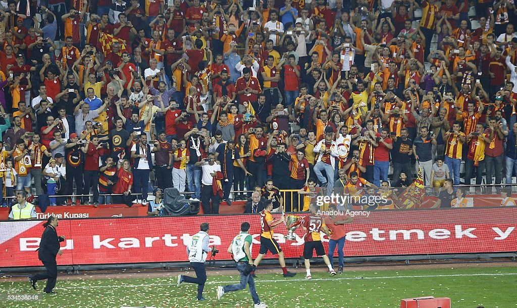 Footballers of Galatasaray and fans celebrate after Galatasaray won the Ziraat Turkish Cup Final match between Galatasaray and Fenerbahce at Antalya Ataturk Stadium in Antalya, Turkey on May 26, 2016.