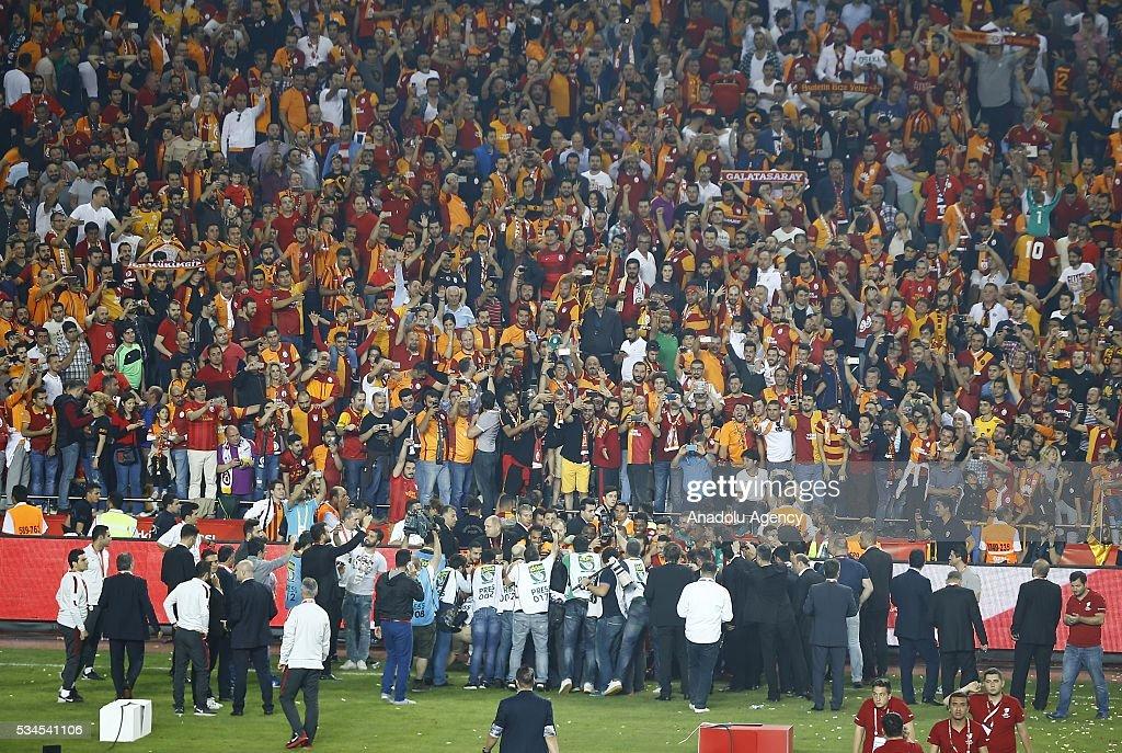 Footballers of Galatasaray and fans celebrate after Galatasaray won the Ziraat Turkish Cup Final match between Galatasaray and Fenerbahce at Antalya Ataturk Stadium in Antalya, Turkey on May 26, 2016.