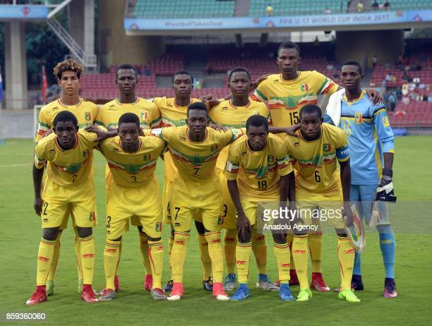 Footballers of Mali pose for a photo during the ceremony within a 2017 FIFA U17 World Cup football match between Turkey U17 and Mali U17 in Mumbai...