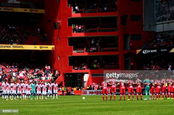Footballers of Necaxa and Toluca pay a minute of silence for the victims of the terrorist attack in Barcelona before their Mexican Apertura football...