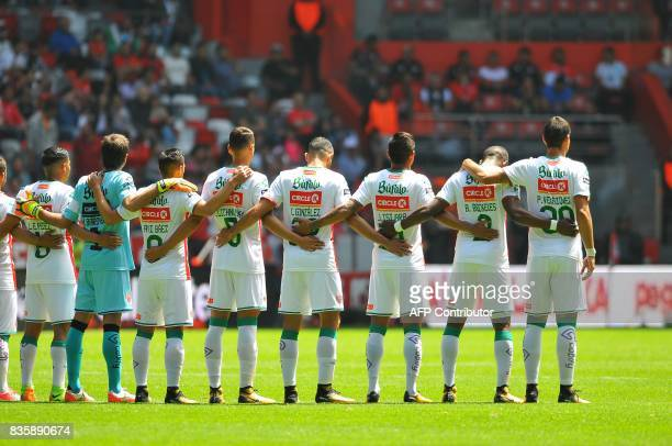 Footballers of Necaxa pay a minute of silence for the victims of the terrorist attack in Barcelona before their Mexican Apertura football tournament...