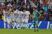 Footballers of Pachuca celebrate their goal against Leon during their Mexican Apertura 2016 Tournament football match at the Hidalgo stadium on July...