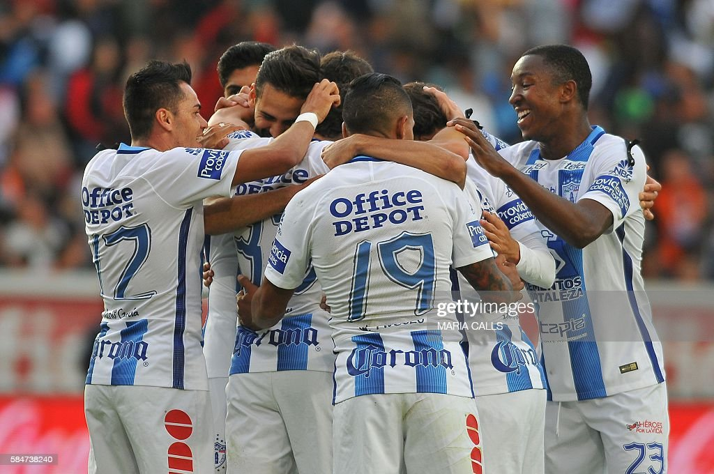 Footballers of Pachuca celebrate their goal against Necaxa during their Mexican Apertura 2016 Tournament football match at the Hidalgo stadium on...