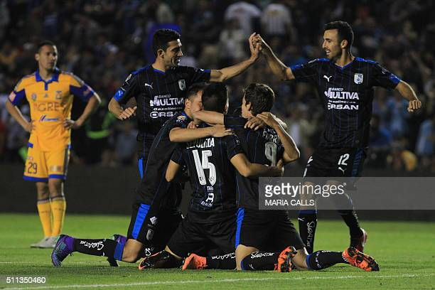 Footballers of Queretaro celebrate their goal against Tigres during their Mexican Clausura 2016 Tournament football match at the La Corregidora...