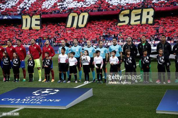 Footballers of Real Madrid and Atletico Madrid are seen ahead the UEFA Champions League semi final second leg match between Atletico Madrid and Real...