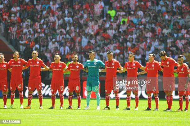 Footballers of Toluca pay a minute of silence for the victims of the terrorist attack in Barcelona before their Mexican Apertura football tournament...