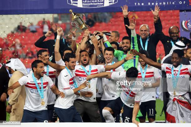 Footballers of Zamalek celebrate after their victory at the end of the Egypt Super Cup final match between Al Ahly and Zamalek at the Mohammed Bin...