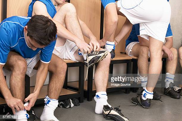 Footballers putting on boots
