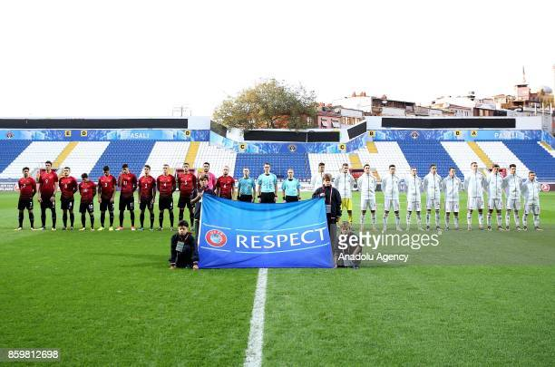 Footballers stand in line before of the 2017 UEFA European Under21 Championship qualification Group 6 football match Turkey and Hungary at Recep...