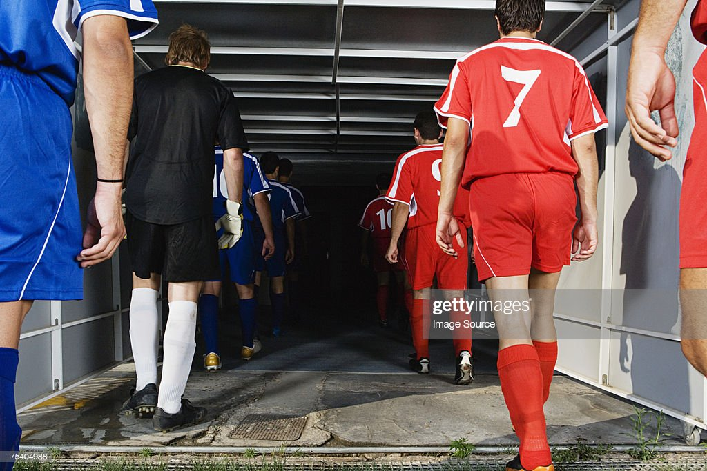Footballers walking into tunnel : Stock Photo