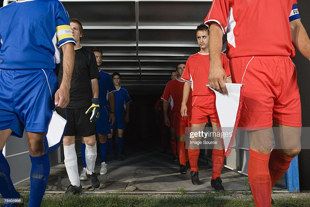 Footballers walking out of tunnel : Stock Photo