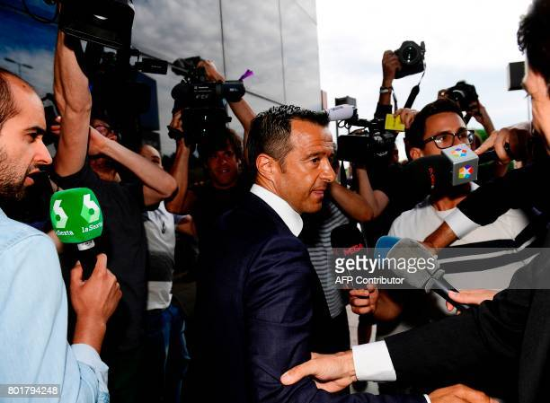 Footballing superagent Jorge Mendes surrounded by journalists arrives at the Court in Pozuelo de Alarcon on June 27 2017 to be questioned by Spanish...