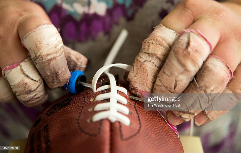 Footballs are laced together by hand using a vinyl fabric material at the Wilson Football Factory in Ada Ohio on Wednesday August 28 2013 Wilson...