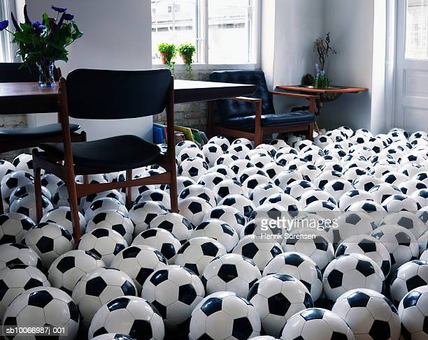 Footballs covering floor of living room
