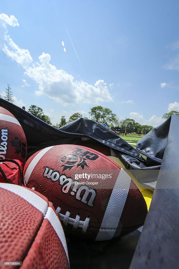 Footballs wait on the sidelines as the Argos take to the field during the 2nd day of Argos rookie camp at St. Thomas Aquinas High School field.