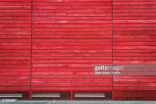 Footpath Against Red Wooden Wall