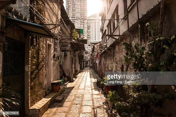 Footpath Amidst Houses In City