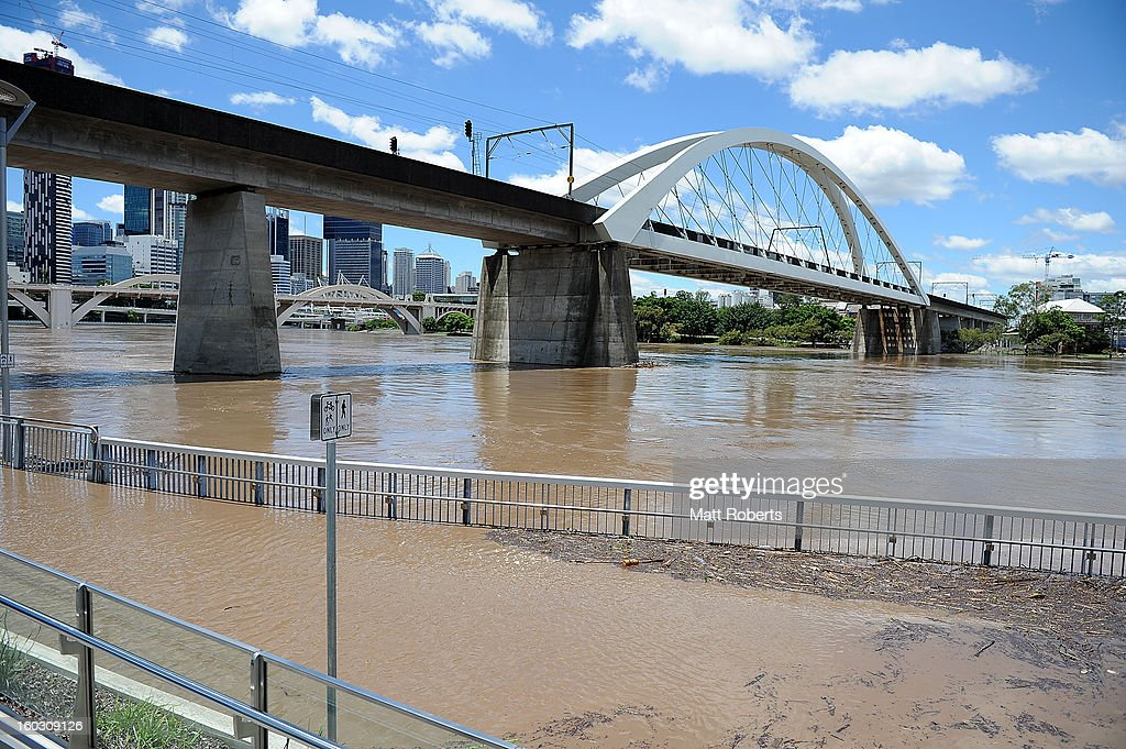A footpath is seen flooded by the Brisbane river as parts of southern Queensland experiences record flooding in the wake of Tropical Cyclone Oswald on January 29, 2013 in Brisbane, Australia. The river in the Brisbane CBD is expected to peak at 2.3 metres today - lower than the 2.6 metre peak predicted - but is still likely to flood low-lying properties and businesses. The flood crisis has claimed four lives so far, with the city of Bundaberg, Queensland faces the worst flooding in its history.
