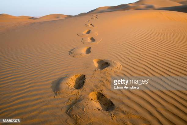 Footprint trail in the sand