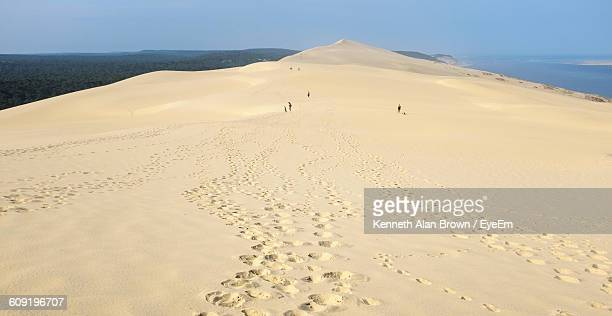 Footprints At Dune Of Pilat Against Clear Blue Sky