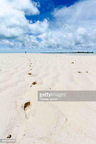Footprints in the sand of the long white beach at Kayangel Atoll, Palau