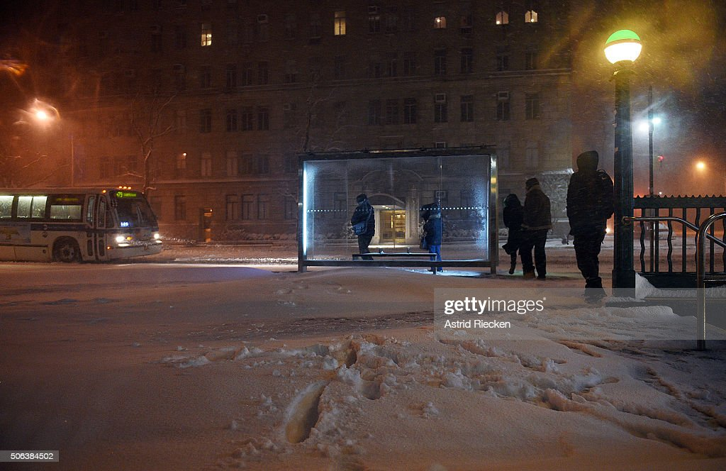 Footprints in the snow lead to where commuters wait at a bus station at West 81st street on January 23 2016 in New York City A major Nor'easter is...