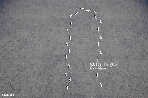 Footprints making a u-turn on cement