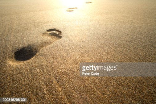Footprints on beach : Stock Photo
