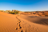 Human footprints in a sandy desert in Abu Dhabi, United Arab Emirates.