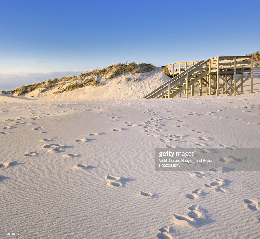 Footprints, ripples and steps on beach