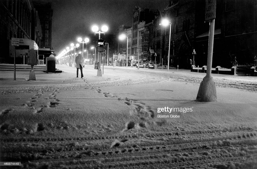 Footsteps in Copley Square as a 5 am commuter scurries for the T