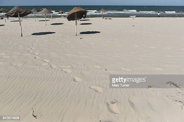 Footsteps in the sand mark out the route to unoccupied parasol spots on the beach north of Sousse Tunisia where the country's tourism industry has...