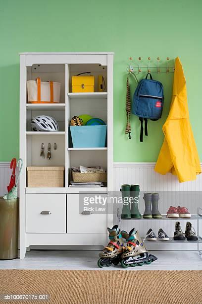 Footwear by cupboard in hallway