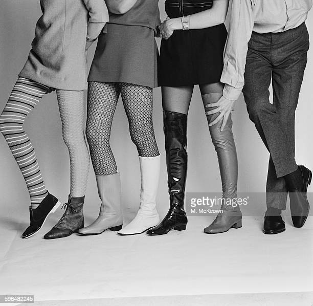 A footwear fashion shoot UK 29th September 1967 From left to right a damson suede 'Charlie' style boot by Lennards with striped stocking by Echo a...