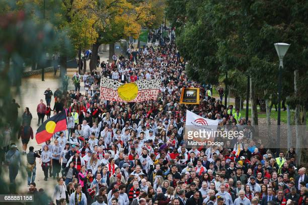 Footy fans and the general public walk during The Long Walk before the round 10 AFL match between the Richmond Tigers and the Essendon Bombers at...