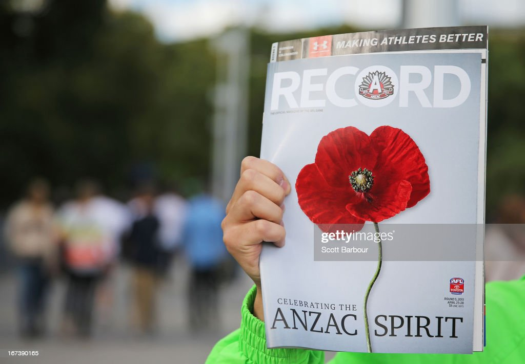 A Footy Record salesman holds a copy of the Record aloft before the round five AFL match between the Essendon Bombers and the Collingwood Magpies at the Melbourne Cricket Ground on April 25, 2013 in Melbourne, Australia. Veterans, dignitaries and members of the public today marked the 98th anniversary of ANZAC (Australia New Zealand Army Corps) Day, April 25, 1915 when allied Australian and New Zealand First World War forces landed on the Gallipoli Peninsula. Commemoration events are held across both countries in remembrance of those who fought and died in all wars.