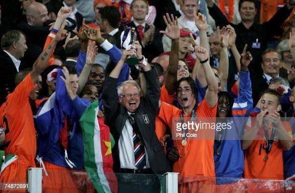 Foppe De Haan Manager of the Netherlands holds the Trophy aloft with Daniel De Ridder after winning the UEFA European Under21 Championship Final...