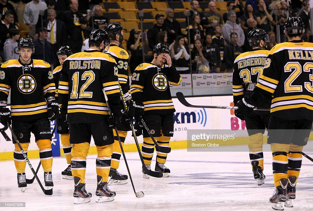 For Boston Bruins defenseman Andrew Ference (#21) and his teammates, the loss in overtime was hard to take. Boston Bruins took on the Washington Capitals in game seven of the Stanley Cup Eastern Conference quarterfinals at TD Garden.