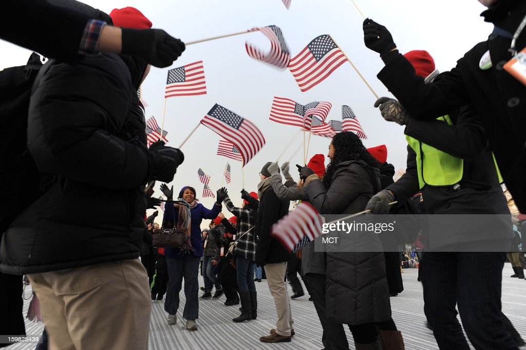 For fun, inauguration volunteers form a flag tunnel for spectators to run through before the start of the inauguration of U.S. President Barack Obama in Washington, D.C., Monday, January 21, 2013.