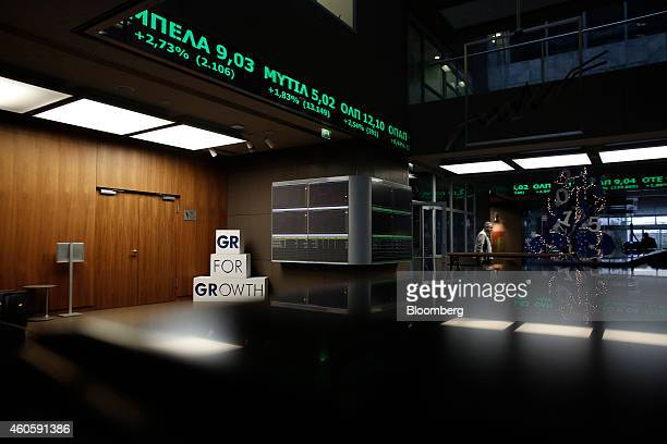 A 'GR for Growth' sign sits beneath a stock prices electronic ticker screen inside the Hellenic Stock Exchange in Athens Greece on Wednesday Dec 17...