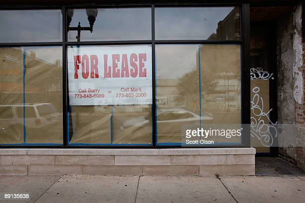 A 'For Lease' sign hangs in a vacant store window along Milwaukee Avenue in the Wicker Park neighborhood July 21 2009 in Chicago Illinois The retail...