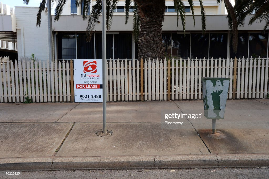 A 'For Lease' sign is displayed on the fence of a former government office building in the mining town of Kalgoorlie, Australia, on Thursday, Aug. 8, 2013. Western Australia, the nation's largest state by area with 2.6 million square kilometers (1 million square miles) of land, earned A$97 billion from minerals and energy sales in 2012, down from A$108 billion in 2011, according to government figures. Photographer: Carla Gottgens/Bloomberg via Getty Images