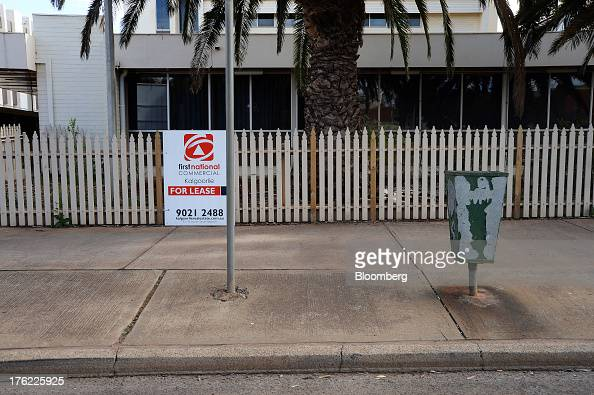 A 'For Lease' sign is displayed on the fence of a former government office building in the mining town of Kalgoorlie Australia on Thursday Aug 8 2013...