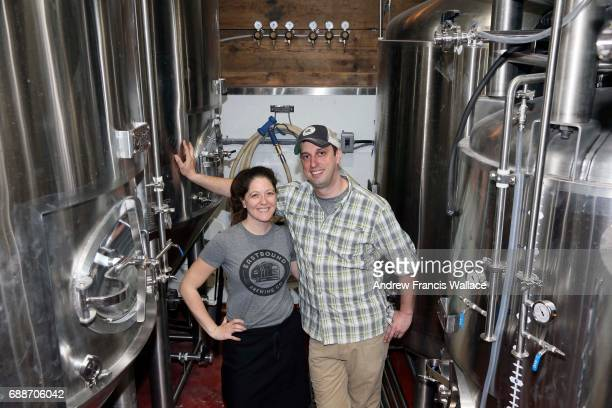 TORONTO ON MAY 19 For NewBusiness profile Eastbound Brewing Dave and Tara Lee pose at the soon to be working brewing area at the Queen St E business...