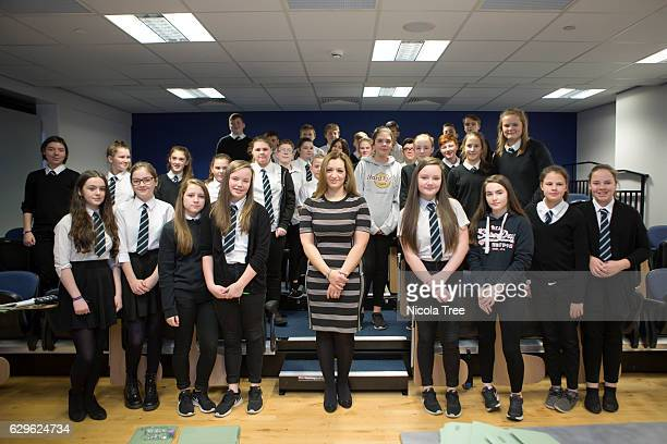 MP for Ochil and South Perthshire Tasmina AhmedSheikh poses with students as she visits Crieff High School in her constituency on December 9 2016 in...